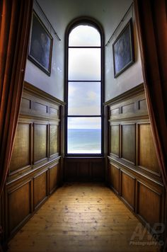 Room with a view by Andrew Wood - I was trying to get the symmetry of this entrance to a window. The photograph brings the viewer in, enticing them to come and see the view beyond.