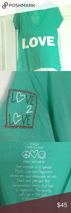 Peace, Love, World I Am Love Tee This beautiful mint tee features so many cute details that I wish I could post more pics! The front says I am Love and the bottom right corner says I am Peace, I am Love, I am Happiness. Each cap sleeve features an embroidered emblem (heart and Love 2 Love.) The back features a PLW quote at the top, has a giant white vinyl heart, and says I am love. It has been worn and washed once & is in perfect condition. Peace, Love, World Tops Tees - Short Sleeve