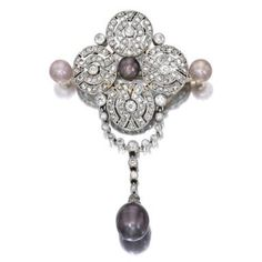 A natural and cultured pearl and diamond brooch, circa 1910