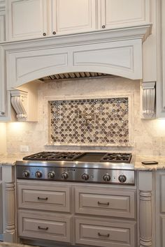 Custom Kitchen by Cleve Adamson Custom Homes. Custom built in hood. Glass Mosaic Tile Focal Point with Pot Filling Faucet, Distressed Antique Look Cabinets, Granite Countertops, Stone Backsplash. Kitchen Redo, Kitchen Backsplash, Kitchen Cabinets, Stone Backsplash, Backsplash Ideas, Kitchen Ideas, Mosaic Backsplash, Kitchen Counters, Dark Cabinets
