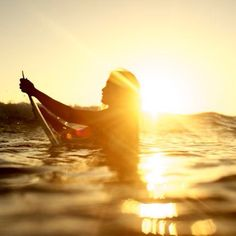 In the water, on a surfbard, watching the sun set...epic
