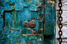 Blue Closed Door by Justin Benson. A blue door chained shut in Barranco, Peru.