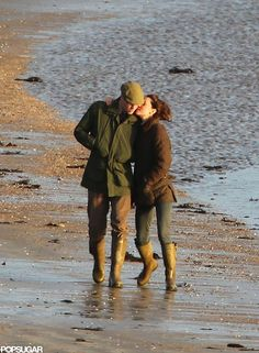 Prince William and Kate Middleton cozied up during a January walk by the water in Wales in 2012.