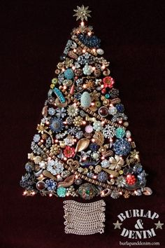 Vintage Jewerly Christmas Tree! My grandma made two, big and small. They now hang at my mom's during Christmas.
