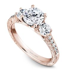 A Noam Carver rose gold engagement ring with 12 diamonds. * Setting only - center diamond sold separately Alexandrite Engagement Ring, 3 Stone Engagement Rings, Rose Gold Engagement Ring, Engagement Ring Settings, Princess Cut Engagement Rings, 3 Stone Diamond Ring, Rose Gold Diamond Ring, Diamond Sizes, Wedding Rings