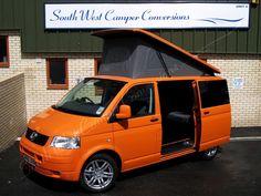 Orange VW T5 campervan