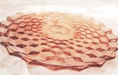 Vintage depression glass. Pink glass cake plate. Rent at www.vintagedishrental.com