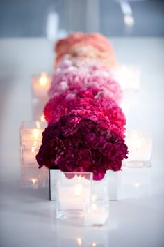 Ombre Centerpieces ~ Carnations = Cheap Genius! ****************** Both flowers and vases can be found at the dollar store for super cheap :)