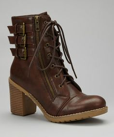 Part Victorian-inspired, part biker chic, this ankle boot shines from dawn till dusk. Distinctive lacing and a three-buckle trim up the ante for style. Best of all, a chunky heel makes stepping out fun.