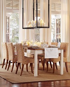 seagrass chairs + farmhouse table with makeshift candle light fixture. I think the french doors and window treatments are my favorite part of this dining room.