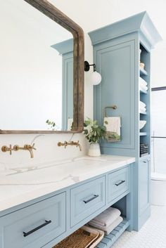 Home Decor Bedroom Check out these gorgeous blue cabinets and brass fixtures. Love the mix of metals Decor Bedroom Check out these gorgeous blue cabinets and brass fixtures. Love the mix of metals Modern Bathroom, Small Bathroom, Master Bathroom, Bathroom Ideas, Bathroom Bin, Bathroom Marble, Bath Ideas, Linen Cabinet In Bathroom, Painted Bathroom Cabinets