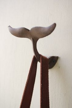 """Cast Iron Whale Tail Wall Hook. Rust Finish. Wall-mounted. (Hardware not included.) Dimensions: 5""""W x 3.5""""D x 4""""H"""