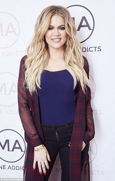 Glamorous: Khloe Kardashian appeared at the Mane University hair and beauty event at Sydney's Langham Hotel on Sunday