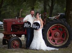 The bride and groom use an old tractor at their rustic barn wedding venue for a prefect picture spot.