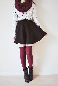 burgundy red tights and scarf, black and white polka dot top, black skirt, black belt and boots