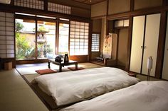 Futons are rolled out daily to make the main room a bedroom. Shoji walls created separation while letting light through.