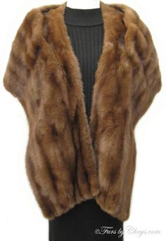 SOLD! Vintage Squirrel Fur Stole; #SS501; Very Good Condition; Size range: S - M. This is a gorgeous vintage genuine squirrel fur stole. It has a DeRepentigny & Robillard Enrg. label and beautiful brown lining with a beige floral pattern and there is NO MONOGRAM. There are no pockets and no closures, but there are shoulder straps that keep it on comfortably. Squirrel fur is unbelievably soft and very warm. This vintage fur stole is a throwback to the glamour of yesteryear. Wear it and dazzle!