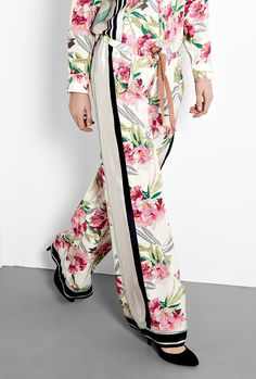 Floral Printed Silk Pyjama Trousers by Elizabeth and James  Stride into summer in these stunning printed silk trousers! In the season's must-have floral print and an achingly cool pyjama style cut these need nothing more than a towering heel and sultry block colour separates to nail the look.  $192