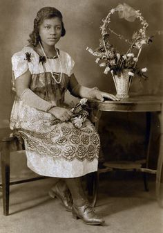 unknown woman sitting for studio portrait, circa 1920
