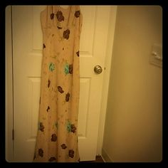 Long dressy beautiful gown, size 13 This is a LONG (62 inches from top of shoulder to base hem line) party gown, size 13. It is a r-wear, rampage clothing co. Dress in a tan color with beautiful brown and teal roses in pattern. There are also sage/lime green hues from the petals and leaves.  This dress is fitted at the top. Measures 19 inches across the back from armpit top armpit. High waist directly under bust line. Very flattering...fits woman's size 10...5 foot 8 or 9, or 10 easily…