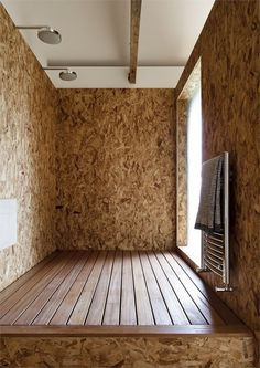 Ochre Barn, Norfolk, 2010 by Carl Turner Architects OSB shower walls with wooden floor