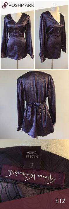 Deep Purple Satin Finish Blouse Deep Purple Satin Finish Blouse. Size large. Very beautiful blouse! Ties in the back and has cuffed sleeves. Thank you for looking at my listing. Please feel free to comment with any questions (no trades/modeling).  •Fabric: 100% polyester  •Condition: EUC, no flaws.   ✨Bundle and save!✨10% off 2 items, 20% off 3 items & 30% off 5+ items! Gloria Vanderbilt Tops Blouses