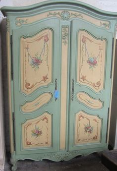 An Unusual 1950  s French Floral Painted 2 Door Armoire
