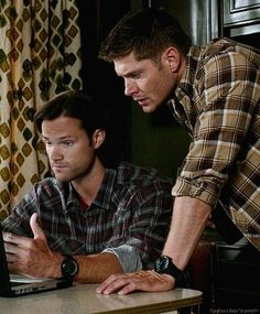 Sam and Dean - 9x05 Dog Dean Afternoon. Doesn't Dean look like a Dad leaning over his kid's shoulder?