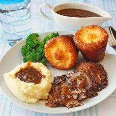 French Onion Braised Beef Brisket - get ready for Slow Cooked Sunday with this fall-apart-tender, delicious beef brisket braised in an easy homemade French Onion Soup. Learn the secrets to perfect Yorkshire Pudding popovers too an absolute must have accompaniment to any roast beef dinner.