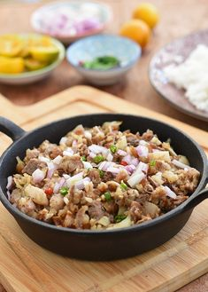 Sizzling Sisig makes a great party appetizer as well as a hearty dinner entree. A delicious combination of juicy pork and tangy, savory and spicy flavor, it's seriously addictive! Spicy Appetizers, Appetizers For Party, Sisig Recipe Philippines, Food Stall Design, Pork Sisig, Rice Recipes For Dinner, Pinoy Food, Dinner Entrees, Food Trends