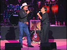 Check out two titans of Texas music: Roberto Pulido and Little Joe. This belongs in a dancehall, not in an auditorium, but the band is top-notch and their voices are great together.