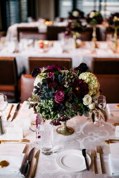 Deeply hued elegant centerpieces: http://www.stylemepretty.com/colorado-weddings/2015/03/26/rustic-fall-wedding-2/   Photography: Ash Imagery - http://ashimagery.com/