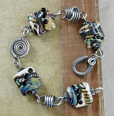 Stunning!!  Love this! look at knot get online and learn how to do and create polymer pillow beads.and Byzantine chain,,,
