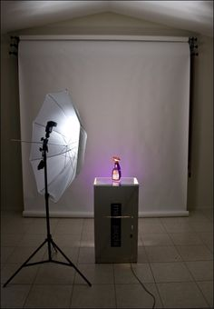 """After taking some shots with the Floor Lit Table Top Studio by Nick, It's time to take it up a notch.    The previous article showed how to take great liquid product shots, though the set up can work for both liquids and solids.    In  this part of the tutorial Nick will show a modification of the setup that allows you to add some color effects to the shot. If you like it, stop by Nick's flickr stream and say """"Hi"""". In addition to showing your appreciation, you'll get some great studio images…"""
