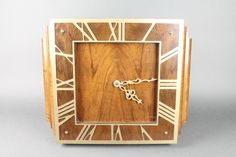 """Lot 797. A Smiths Art Deco electric wall clock with square dial and gilt Roman numerals, contained in a walnut case 21"""" Est £40-60"""