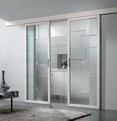 Puerta corrediza de vidrio DEDALO - CRISTAL