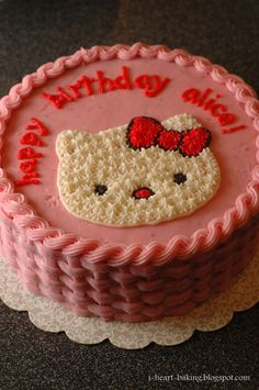 pink hello kitty cake - chocolate cake filled and topped with strawberry buttercream frosting, piped in a basketweave design on the sides, r...
