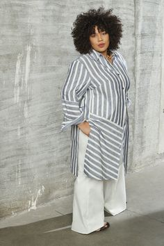 Description The effortless look of a cotton shirt reimagined in a striped cotton/linen blend as a modern tunic. With our classic side cutaway side detail, the Grace tunic can take you from poolside to dinner—just add a white, wide leg trousers and strappy sandals. Details Colors: Blue Multi Closure: Front Materials: 100% Cotton Fabric: Medium Weight Shirting Care Instructions: Dry Clean Only Size and Fit Fits True To Size Non Stretch Fabric Vented Sides More Questions? Email: admin@paripassushop Cotton Linen, Cotton Fabric, Cutaway, Wide Leg Trousers, Strappy Sandals, Stretch Fabric, Blue And White, Tunic, Dinner