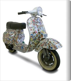 Vintage soccer stickers cover this Vespa