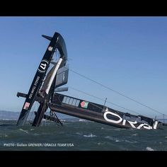 The #oracleteamusa crew is busy making plans for our capsized #AC72 - #capsize #sailing #sfbay #wing #damaged #sanfrancisco #crash #pickingupthepieces #extreme