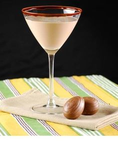 3 oz Vanilla Vodka  1.5 oz Creme de Cacao  1.5 oz Cream Liqueur  1 oz Caramel Liqueur  splash of Cream    Melt some semi-sweet chocolate and rim a martini glass. Drizzle extra chocolate in the glass and chill.    Meanwhile, combine Vanilla Vodka, Creme de Cacao, Cream Liqueur, Caramel Liqueur and cream in a martini shaker with ice. Shake until chilled and pour into glass. Enjoy!