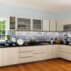 Set in U-shaped layout this kitchen provides impressive storage for all your fundamentals. The multi-colored Moroccan tile backsplash adds a pop to this otherwise neutral setting. Beautiful white oak laminates on the cabinets gives this kitchen a sweet and classy look.