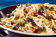 It's one part broccoli slaw, one part pasta salad. And with cranberries and almonds, everyone will find something to like about this sweet side dish.