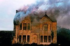 The 17th Century manor house on fire. This amazing photograph was taken in 1989 by a passer-by who happened to have his camera with him. David and Martha have since transformed the manor into an elegant and serene home.