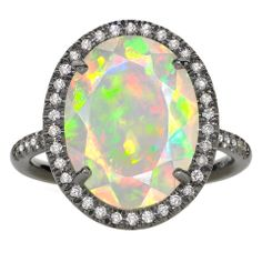I love my birthstone: Opal. This ring is amazing! I would never have any place fancy enough to wear it!