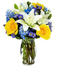 The Winter Wonderland Bouquet: winter-inspired bouquet of yellow roses, white lilies, blue delphinium, and purple monte casino. <3 #flowers