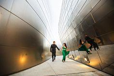 engagement photo of couple running through Walt Disney Concert Hall