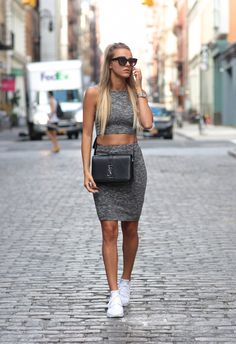 A grey skirt and crop top combo goes fabulously with a pair of white sneakers! Via skopljak Set: Nelly, Shoes: Nike