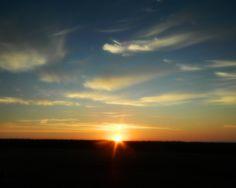 Iowa sunrise over cornfield