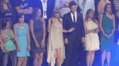 """These 14 GIFs of Taylor Swift Dancing at Awards Shows are Sure to Make You Giggle. One of them says """"the guy next to her seems unimpressed"""" and I'm like """"well that's her brother"""""""